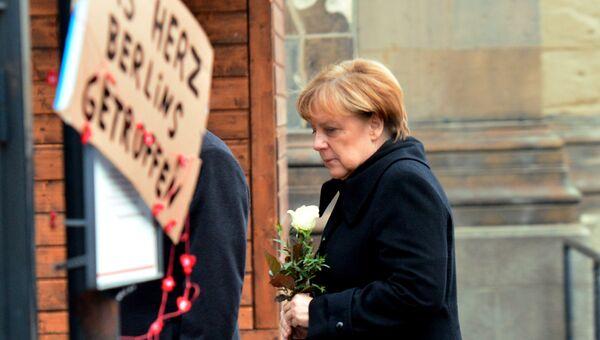 Канцлер Германии Ангела Меркель на месте теракта в Берлине. 20 декабря 2016