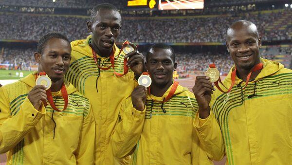 Ямайские бегуны, завоевавшие золото в эстафете 4х100 метров на Олимпиаде в Пекине. Архивное фото