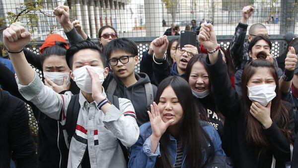 Акция протеста против убийства французскими полицейскими китайца в Париже