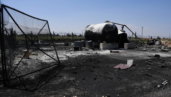 Последствия ракетного удара США по авиабазе Шайрат в Сирии