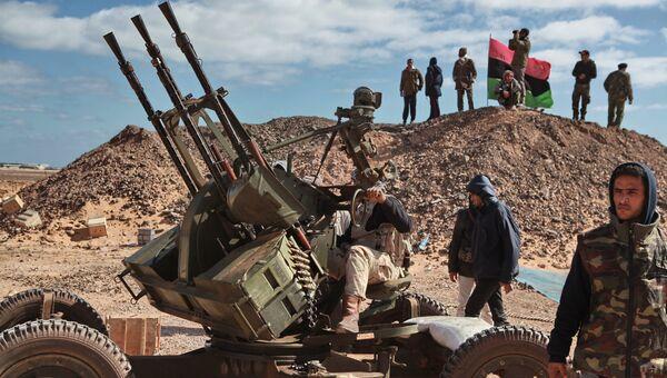 Расчет зенитного пулемета в окрестностях города Бин Джавад, Ливия. Архивное фото