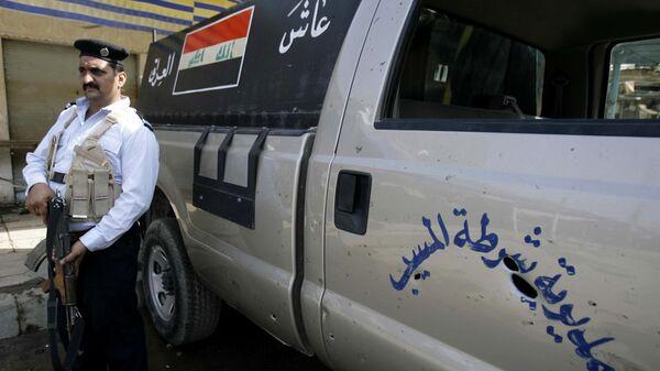 Сотрудник полиции в городе Эль-Мусайиб, Ирак