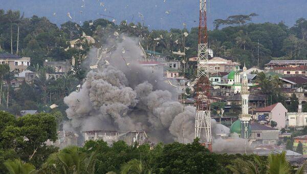 Боевые действия в городе Марави, на юге Филиппин. 9 июня 2017. Архивное фото