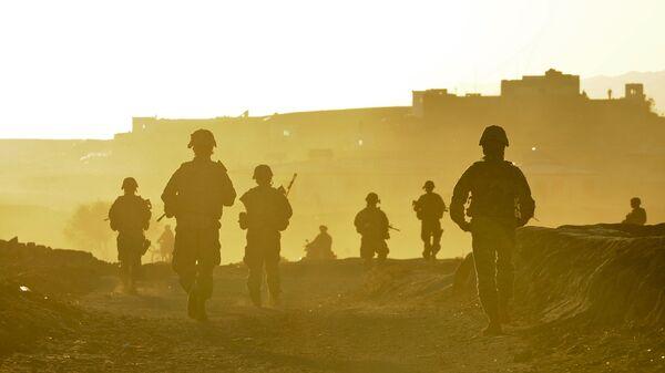Американские военнослужащие возвращаются на базу после патрулирования территории возле города Калат, Афганистан