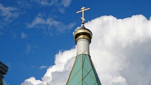 Вид русского храма в Страсбурге, увенчанного трехметровым золоченым крестом
