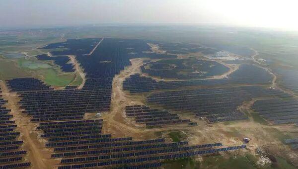 Cолнечная электростанция в форме панды в Китае