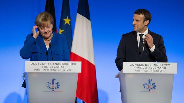 Ангела Меркель и Эммануэль Макрон. Архивное фото