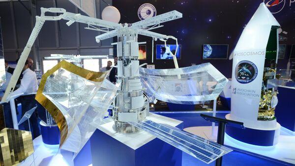 Макет космического аппарата Пион-НКС на стенде Федерального космического агентства Роскосмос на МАКС-2017 в Жуковском