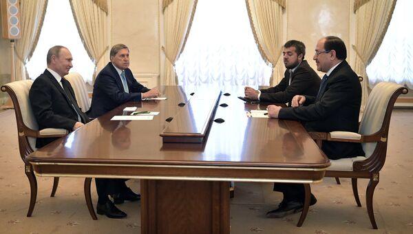 Президент РФ Владимир Путин и вице-президент Ирака Нури аль-Малики во время встречи. 25 июля 2017