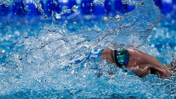 Вероника Попова (Россия) в соревнованиях по плаванию на дистанции комбинированной эстафеты 4х200 м на XVII чемпионате мира по водным видам спорта в Будапеште