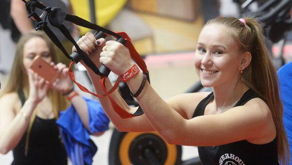 Участница во время проведения Московского международного открытого фестиваля фитнеса. 26  ноября 2016
