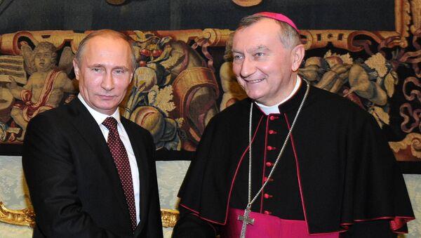 Президент России Владимир Путин и госсекретарь Ватикана Пьетро Паролин. Архивное фото