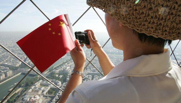 Китайский турист в Европе. Архивное фото