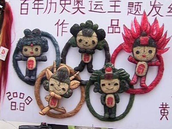 Пекинский парикмахер строит Олимпиаду из волос
