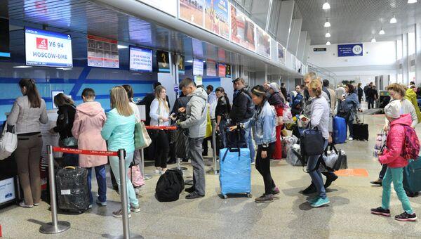 Регистрация пассажиров в аэропорту. Архивное фото