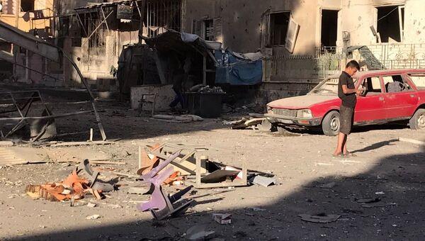 Последствия ракетного обстрела квартала Аль-Кусур в сирийском Дейр-эз-Зоре. 6 октября 2017