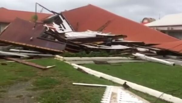 Разрушенное здание парламента островного государства Тонга