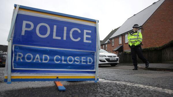 Британские полицейские дежурят возле дома в Солсбери, где жил бывший полковник ГРУ Сергей Скрипаль. 10 марта 2018