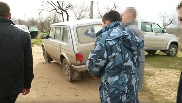 Следственные действия с обвиняемым в жестоком убийстве семьи Ларьковых в Крыму. 12 марта 2018