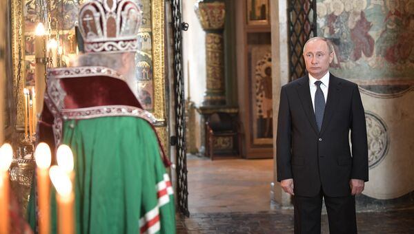 Президент РФ Владимир Путин и патриарх Московский и всея Руси Кирилл во время благодарственного молебна по случаю инаугурации. 7 мая 2018