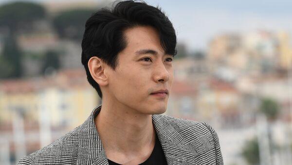 Актер Тео Ю на фотосессии фильма Кирилла Серебренникова Лето в рамках 71-го Каннского международного кинофестиваля