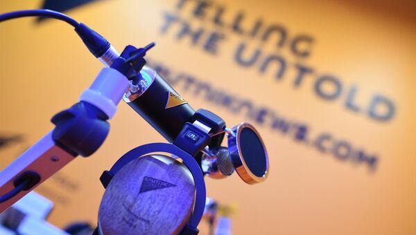 Стенд международного информационного агентства и радио Спутник на Санкт-Петербургском международном экономическом форуме