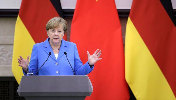 Канцлер Германии Ангела Меркель на пресс-конференции после переговоров с премьером Госсовета КНР Ли Кэцяном. 24 мая 2018