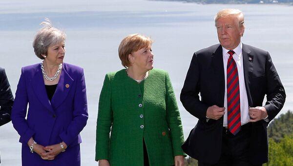 Премьер-министр Великобритании Тереза Мэй, канцлер Германии Ангела Меркель и президент США Дональд Трамп на саммите G7 в Квебеке