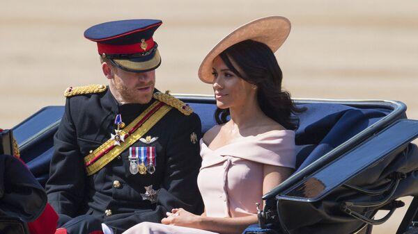 Принц Гарри с женой Меган Маркл на параде Trooping of the Colour по случаю официального дня рождения королевы Елизаветы II. 9 июня 2018