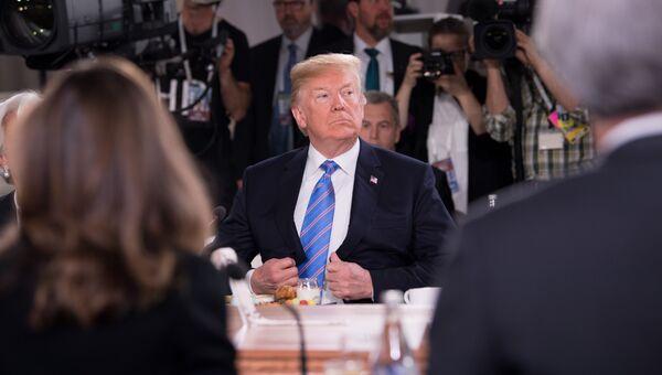 Президент США Дональд Трамп на саммите G7. 9 июня 2018