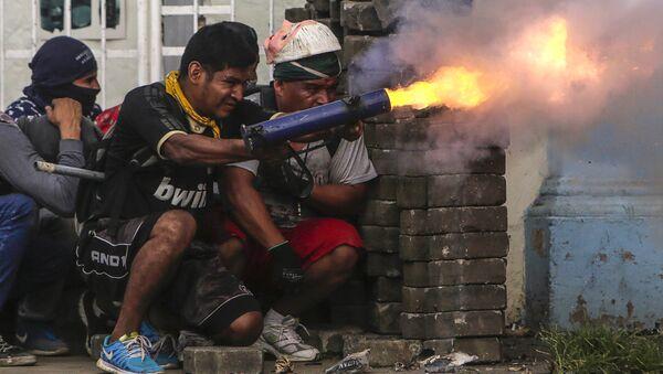 Демонстрант во время акции протеста против правительства Никарагуа. Архивное фото