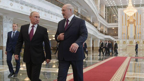 Президент РФ Владимир Путин и президент Белоруссии Александр Лукашенко во время встречи в Минске. 19 июня 2018