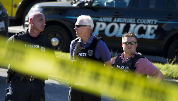 Полиция штата Мэриленд рядом с местом преступления возле гедакции газеты Capital Gazette в Аннаполисе. 28 июня 2018