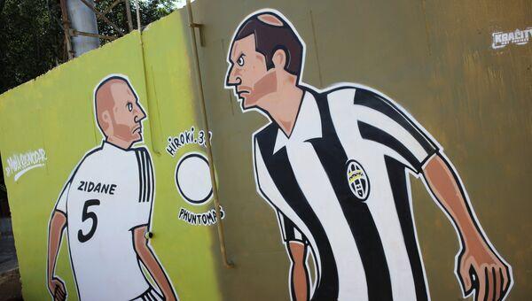 Граффити с изображением французского футболиста Зинедина Зидана на стене дома в Краснодаре