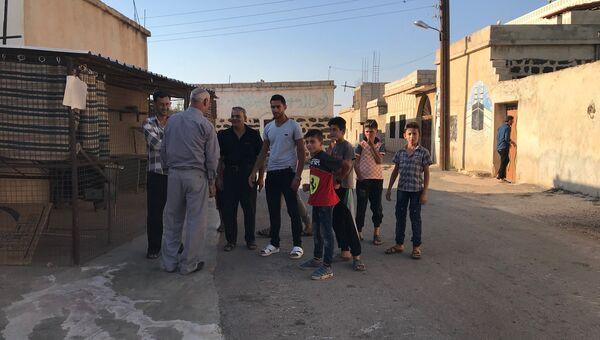 Жители поселка Альма в провинции Дераа, вернулись в свои дома после освобождения населенного пункта от террористов. 18 июля 2018