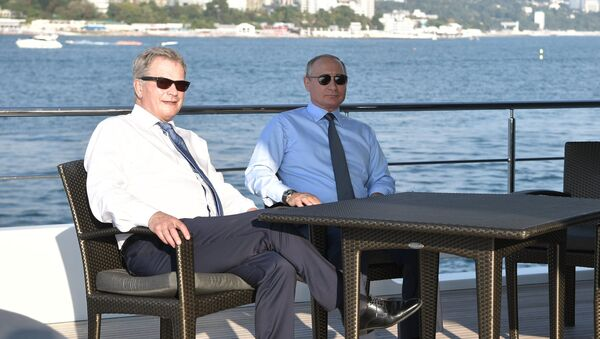 Президент России Владимир Путин и президент Финляндии Саули Ниинистё во время морской прогулки. 22 августа 2018