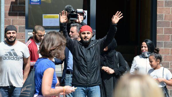 Мигранты во время акции против беженцев в Берлине