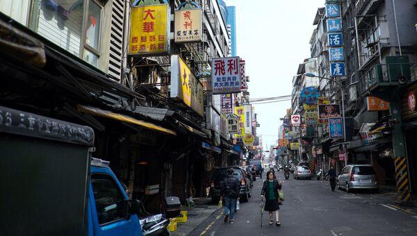На одной из улиц города Цзилун, Тайвань. Архивное фото