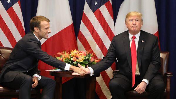 Президент Франции Эммануэль Макрон и президент США Дональд Трамп во время встречи на полях Генассамблеи ООН в Нью-Йорке. 24 сентября 2018