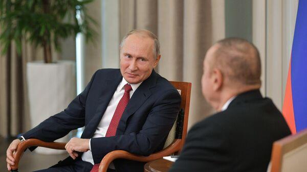 Президент РФ Владимир Путин и президент Азербайджана Ильхам Алиев. Архивное фото