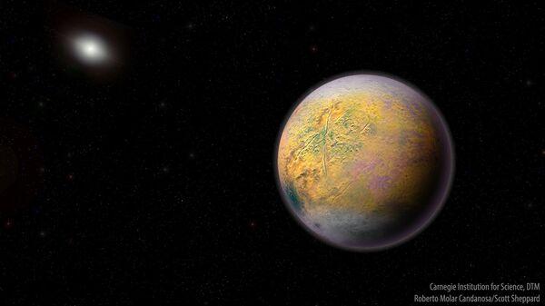Так художник представил себе планету-икс, дирижирующую движением карликовых миров Солнечной системы