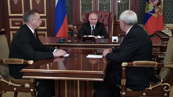 Президент РФ Владимир Путин во время встречи с Александром Бегловым и Георгием Полтавченко в Санкт-Петербурге. 3 октября 2018