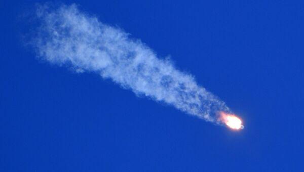 Ракета-носитель Союз-ФГ с пилотируемым кораблем Союз МС-10 после старта с космодрома Байконур