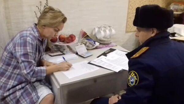Бывшая первый замминистра социальной политики Красноярского края Наталья Колягина во время обыска