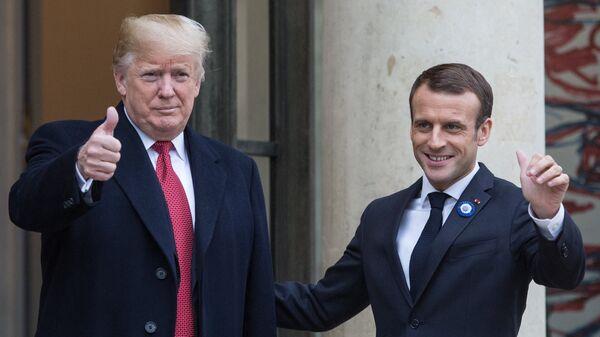 Президент Франции Эммануэль Макрон принимает президента США Дональда Трампа в Елисейском дворце в Париже. 10 ноября 2018