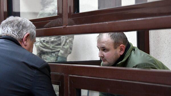 Задержанный старший матрос Юрий Безъязычный в суде Симферополя. Архивное фото