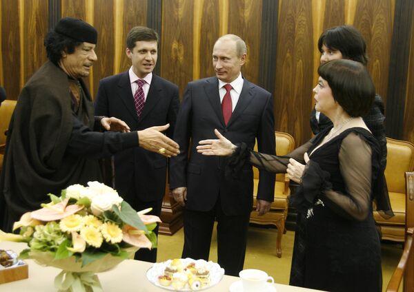 Владимир Путин, Муамар Каддафи, Мирей Матье