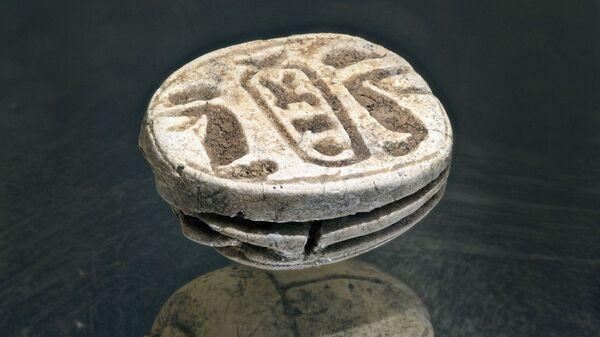 Оберег, найденный в одной из могил в гробнице
