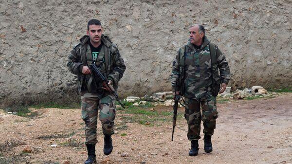 Военнослужащие сирийской армии на западе района Манбидж