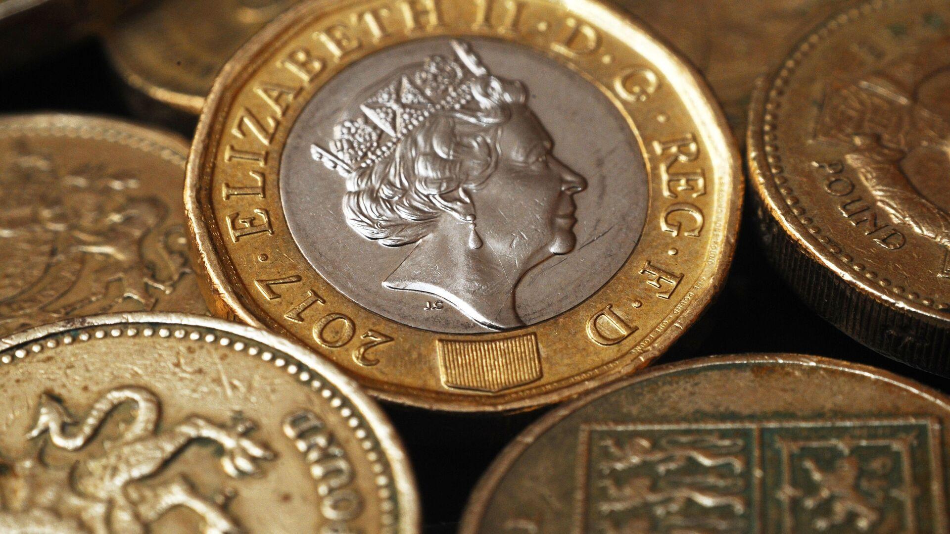 Монеты Великобритании номиналом один фунт стерлингов - РИА Новости, 1920, 20.02.2021
